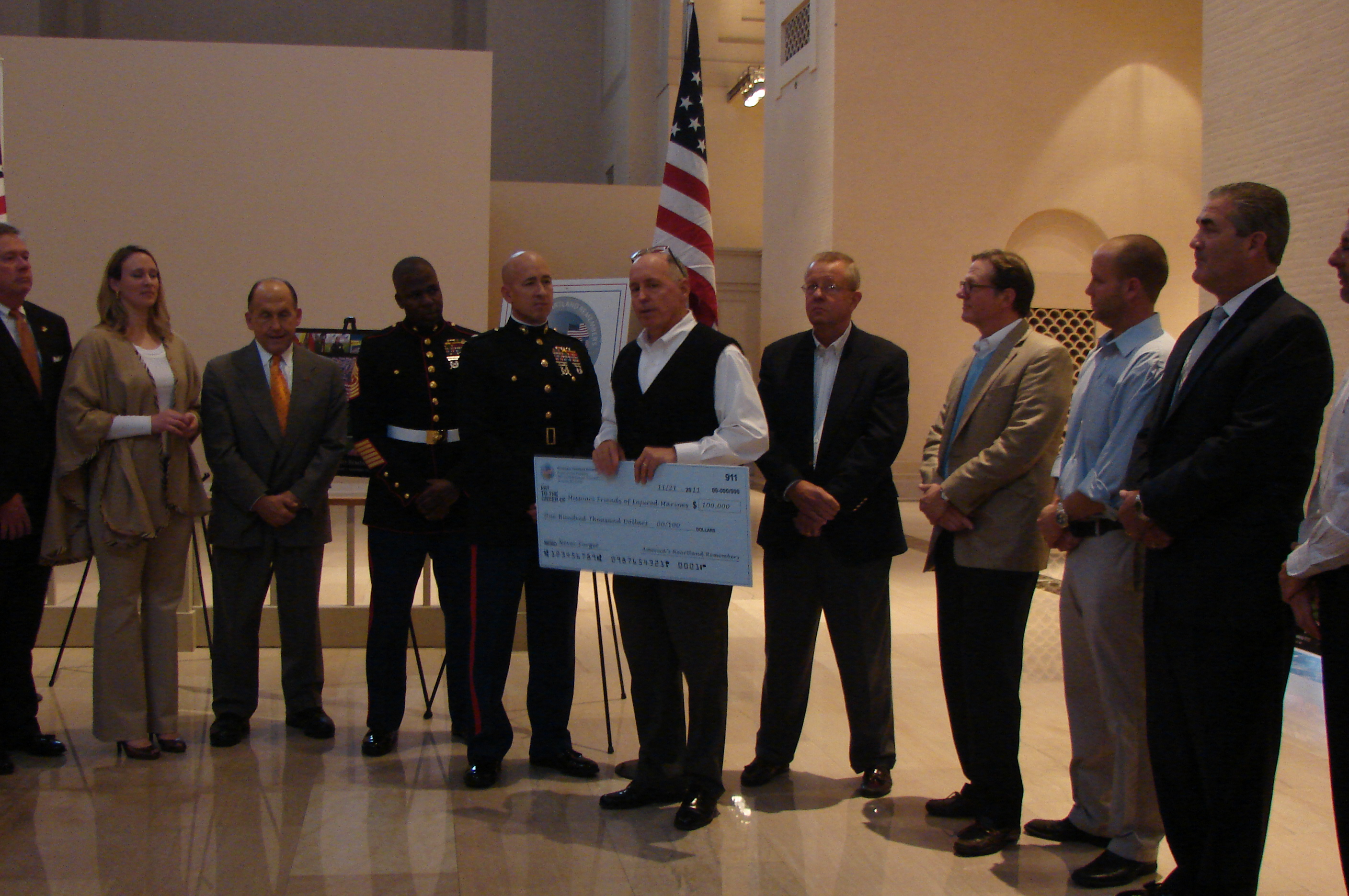 check presentation to Missouri Injured Marine Fund